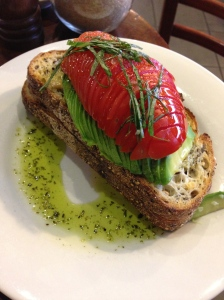 Soy & quinoa toast with avocado, tomato & basil olive oil. Get in mah belleh.